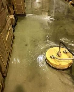 Cleaning a warehouse floor without the need to shift stock with a whirlaway machine.