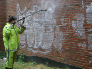 Removing graffiti bricks with light mortar.