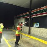 Shop front of petrol station night cleaning