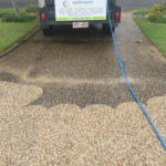 pressure cleaning a concrete driveway